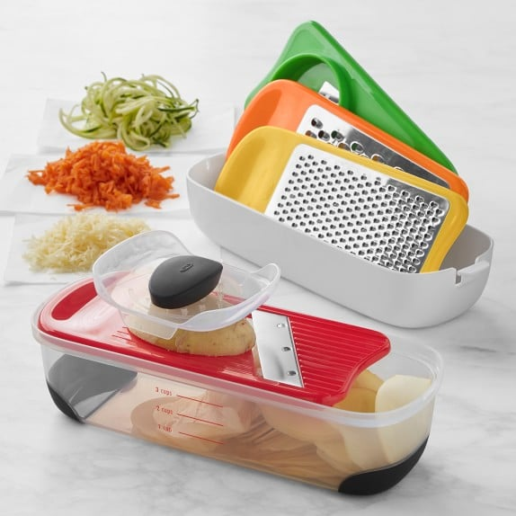 Grater, slicer and plastic holder set with three groups of chopped vegetables