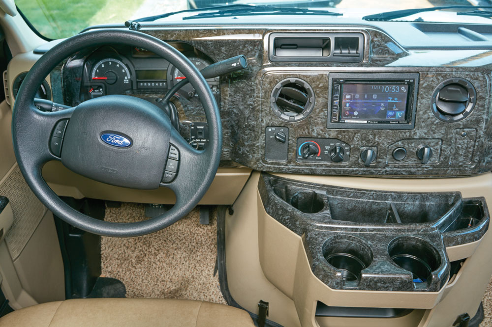 The carpeted cockpit is set up for efficiency and comfort and features an attractive burlwood-finish dashboard. There are good nooks and crannies for stowing small and large items.