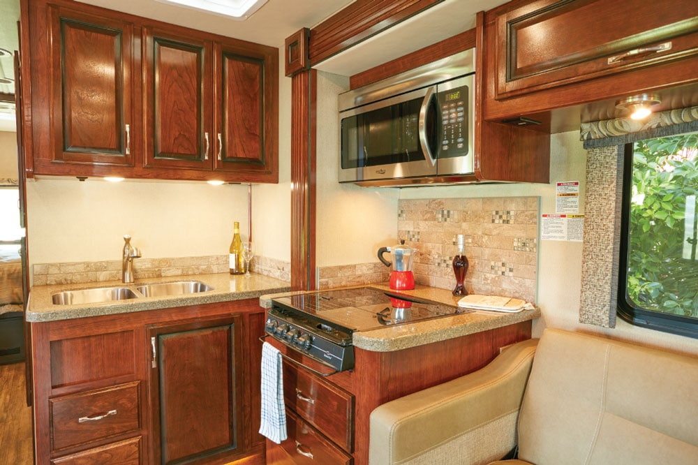 The proximity and angle of the range and microwave in relation to the countertop and sink make cooking up a meal straightforward. Sink covers offer additional solid-surface countertop space.