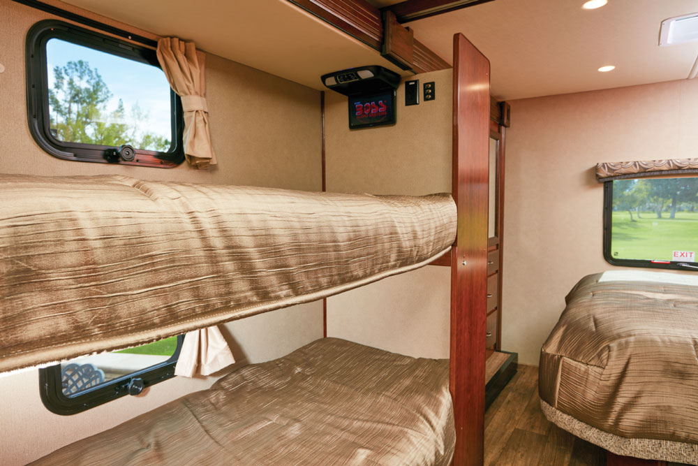 The bunk beds and the wardrobe and dresser for the master bedroom are housed in a slide across from the bathroom. The master can be sectioned off from the bunks via a sliding door. Each bunk has its own DVD player and there are storage drawers at the base of the bottom bunk.