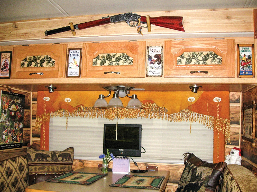 Every corner of this Concord motorhome is outfitted as a mountain getaway. Beneath the nonfiring Winchester rifle, bears adorn the walls (and pillows) of the dinette area.