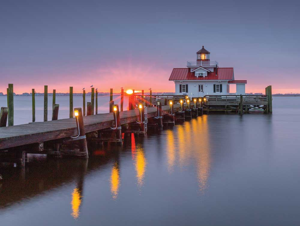 Manteo's Roanoke Marshes Light is a replica of the cottage-style screw-pile lighthouse that stood at the entrance to Croatan Sound. The lighthouse contains exhibits highlighting the area's maritime history and guides boats into Shallowbag Bay.