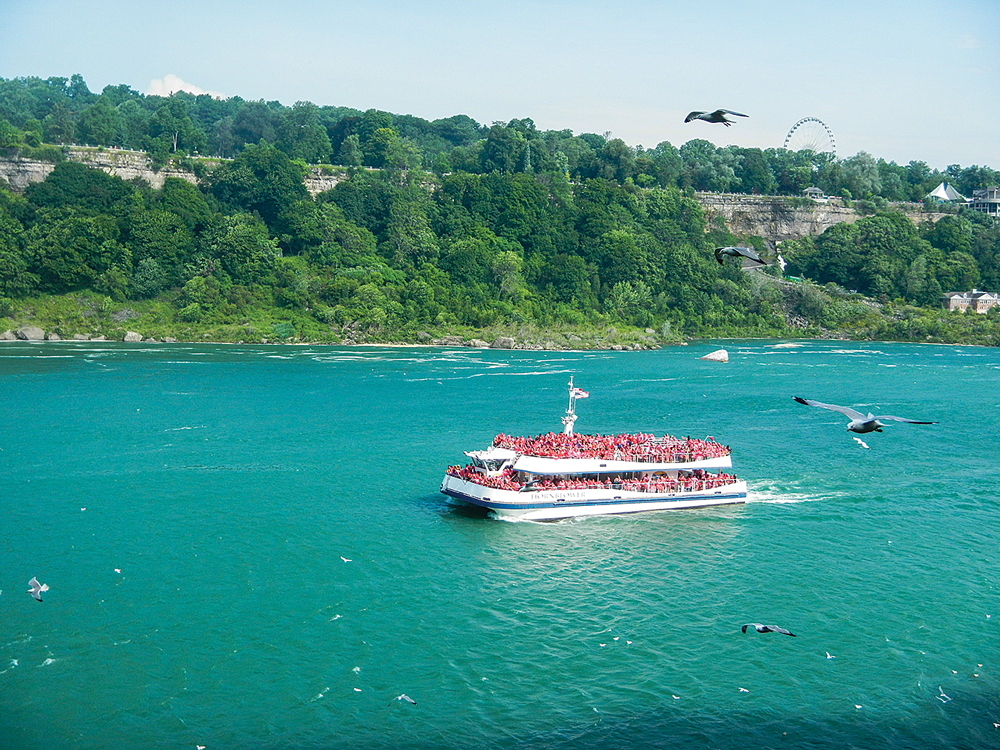 A packed passenger ferry heads up the Niagara Gorge toward the famous falls.