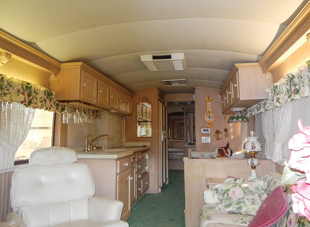 Victorian frills and lighter surfaces made the Prevost conversion's old interior seem too dated for the Elliotts.