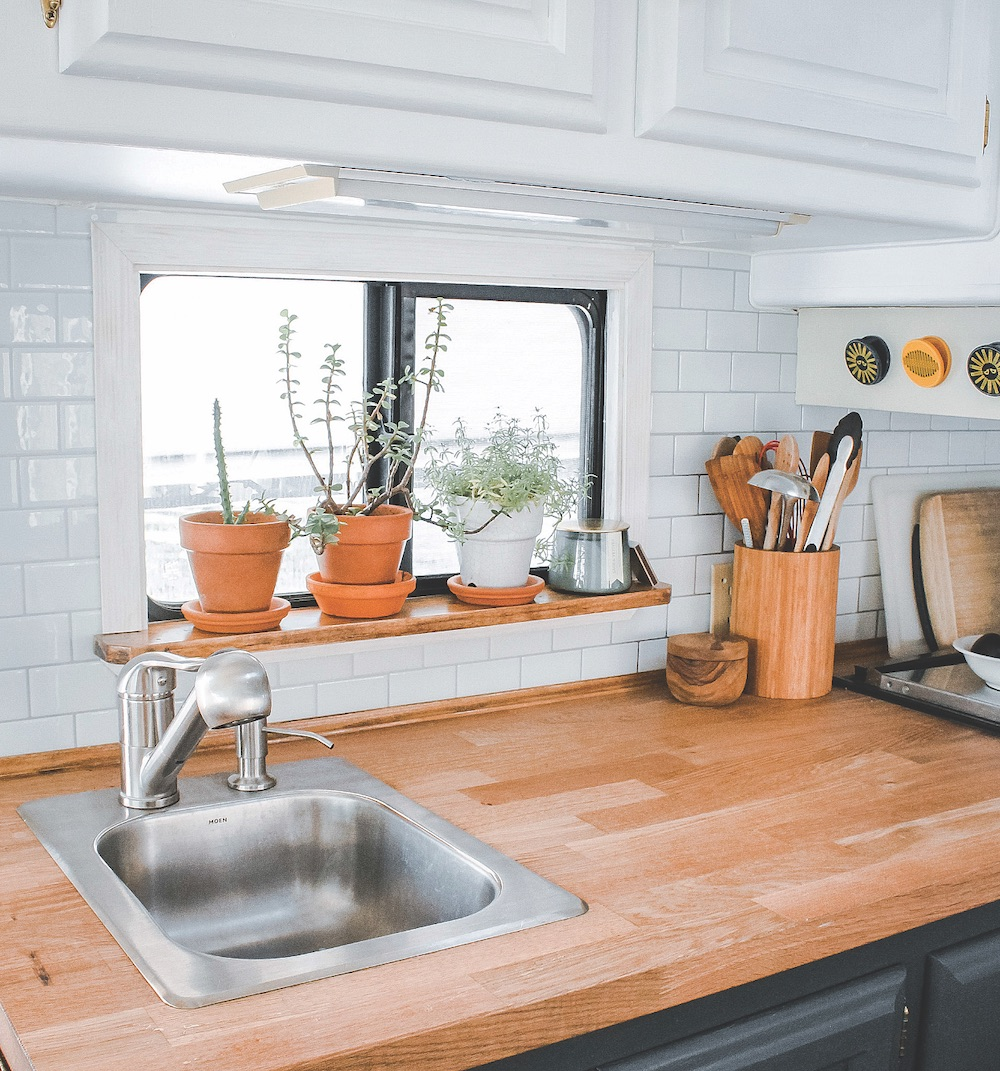 rv remodeled kitchen with peel and stick backsplash