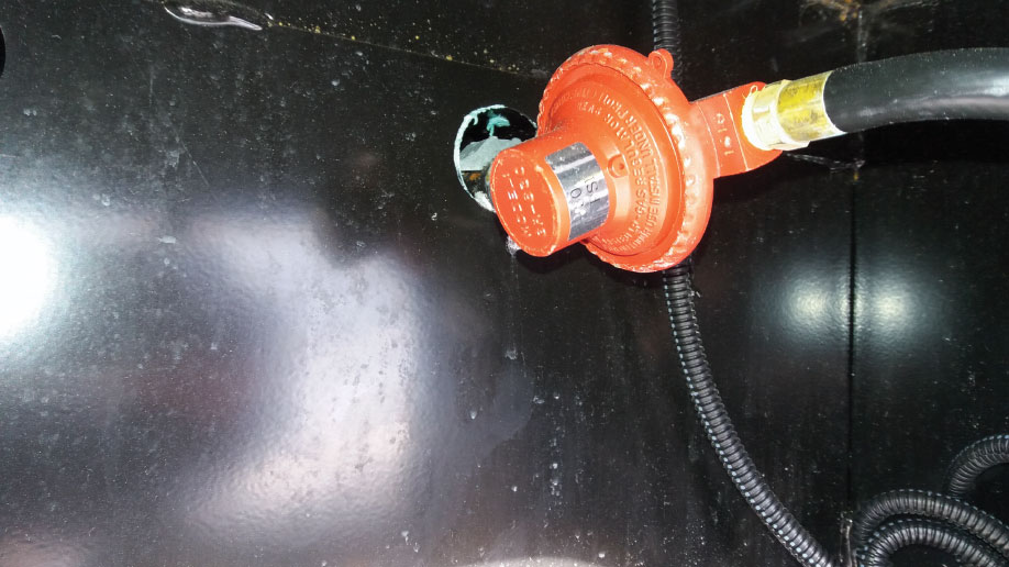 Step-down regulators reduce pressure, preventing condensation when a long hose connects cylinders housed in separate compartments, a common setup on fifth-wheels.