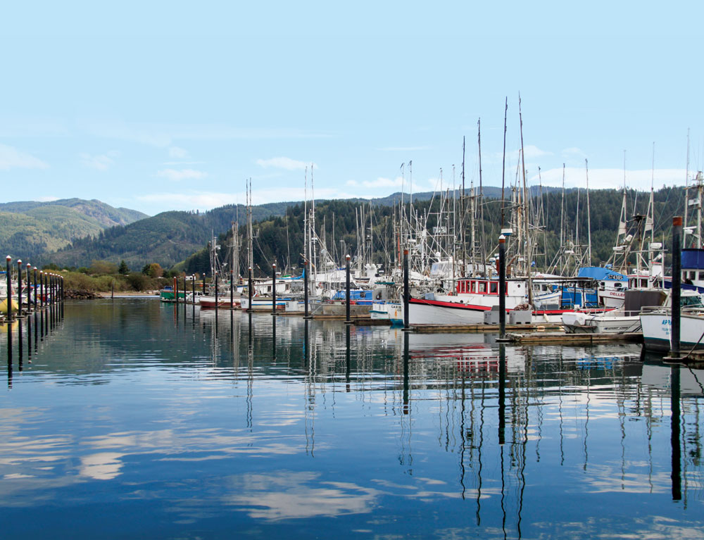 Clouds cast reflections in the water at Garibaldi Marina, where you can rent a boat and traps for catching crabs.