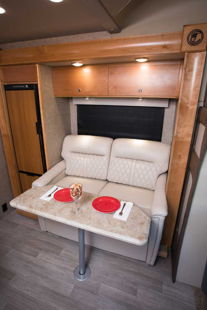The cozy two-person sofa tucked into the slideout offers additional sleeping accommodations for guests.
