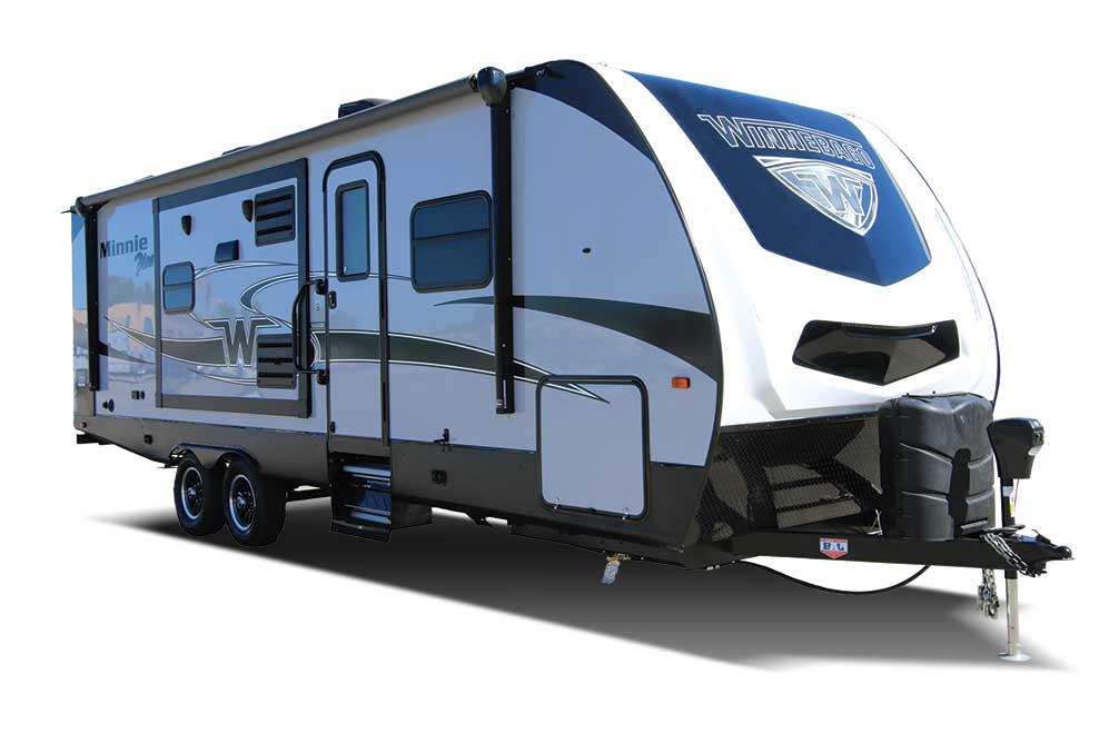 White and blue designed Winnebago travel trailer