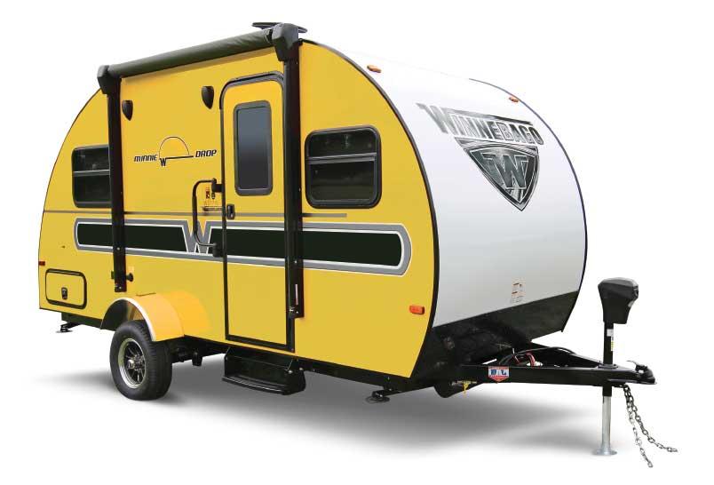Bright yellow Winnebago Minnie Drop curved travel trailer