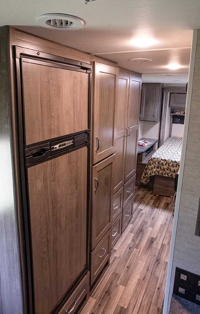 Chill and fill: The hallway leading back to the bedroom from the living area features a 7.5-cubic-foot refrigerator that blends in nicely alongside the pantry, a large wardrobe and drawers for lots of packing space.