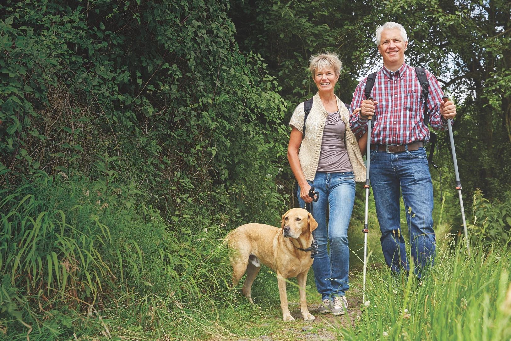 hiking-couple-with-dog-AdobeStoc