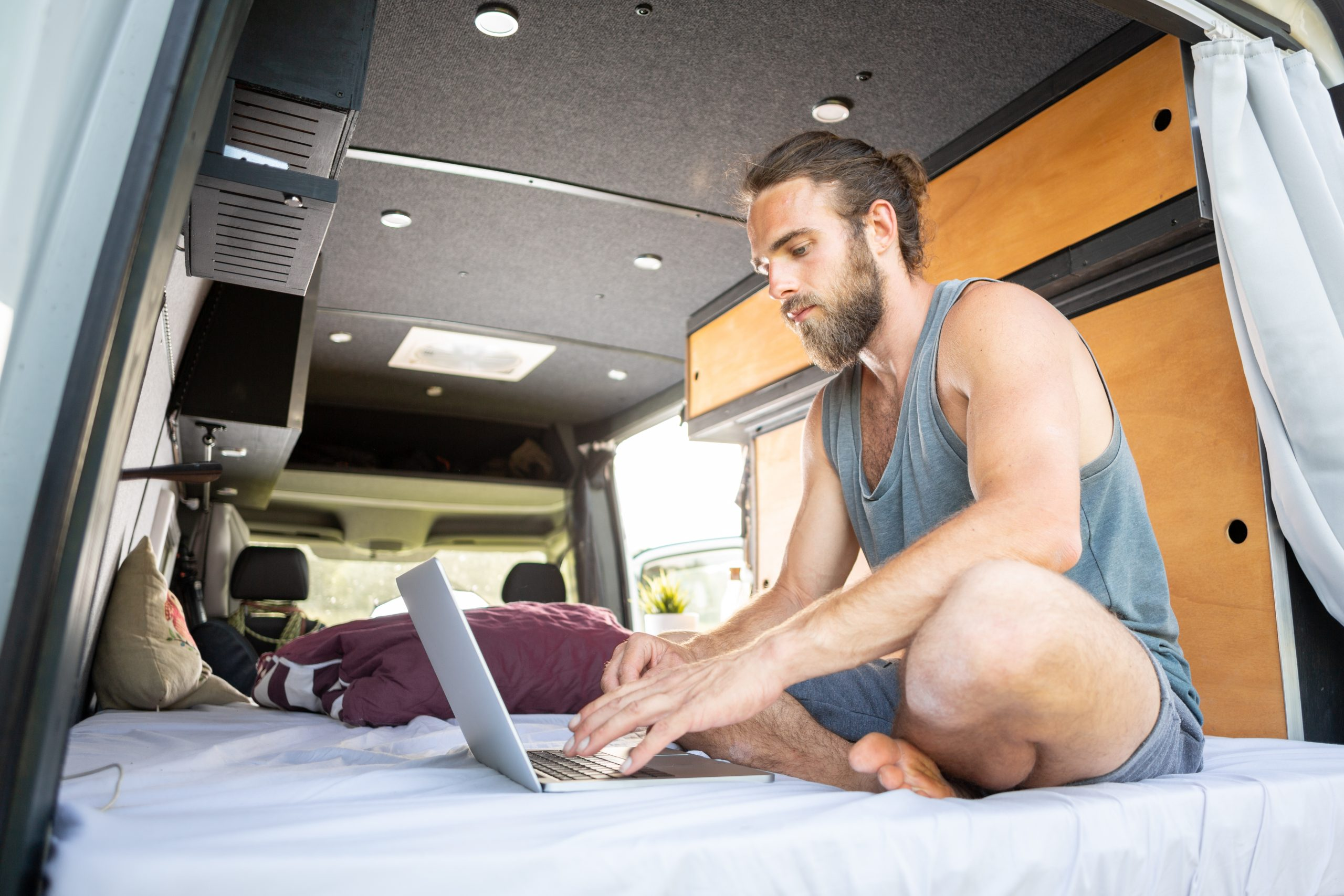Man in Camper Laptop Work Remote