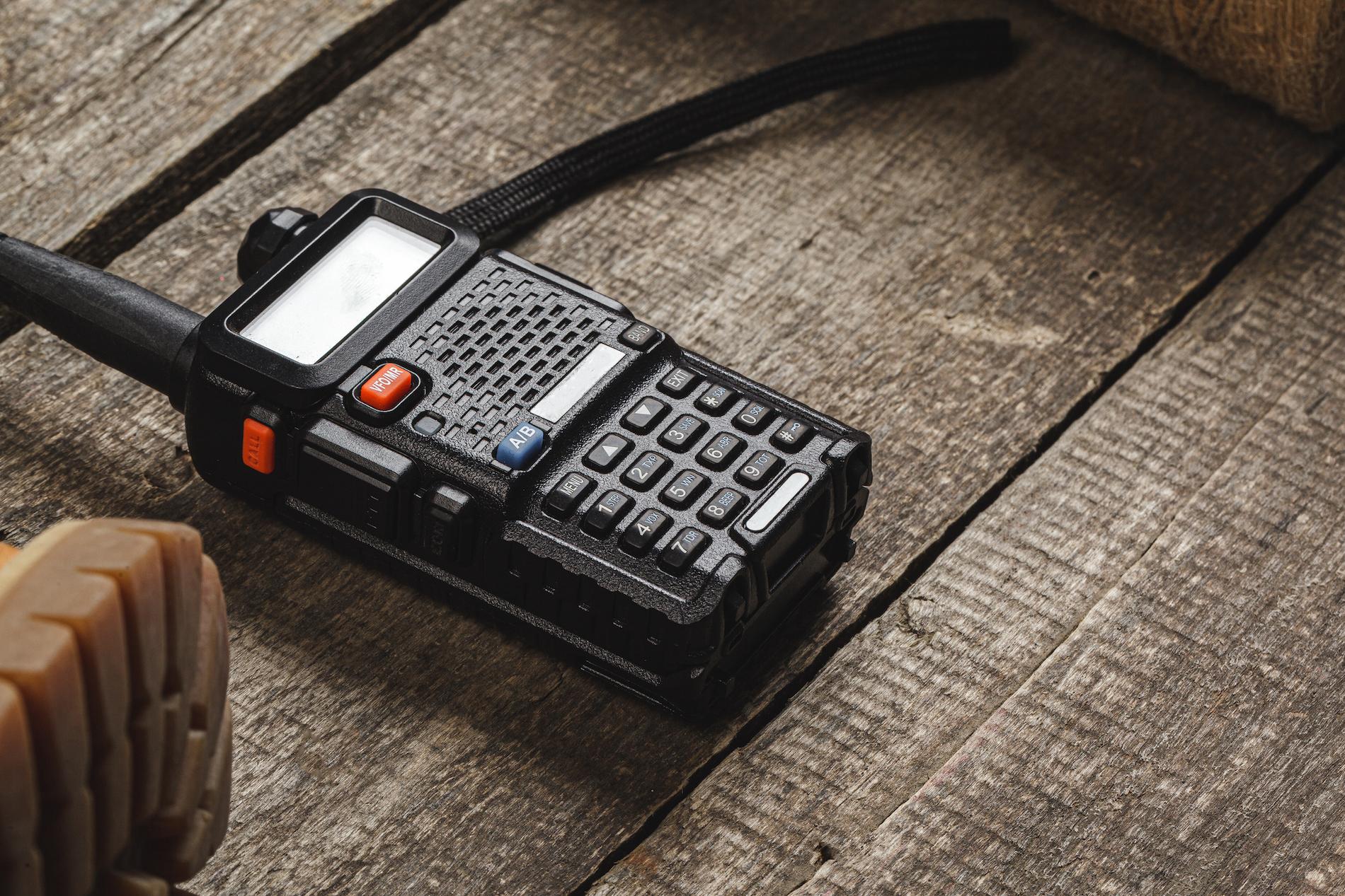 Walkie talkie radio set on wooden table close up