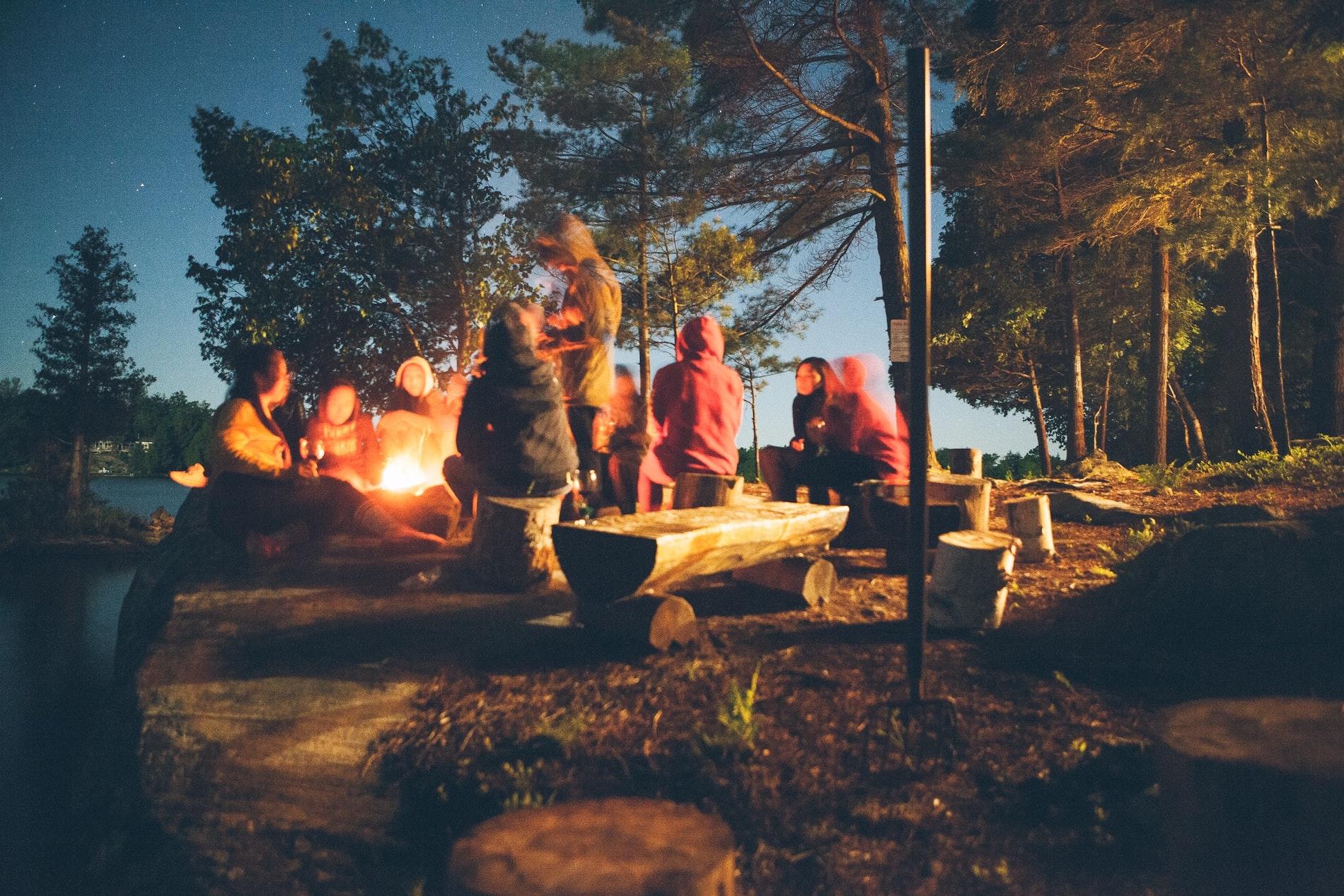 camping kids around a fire