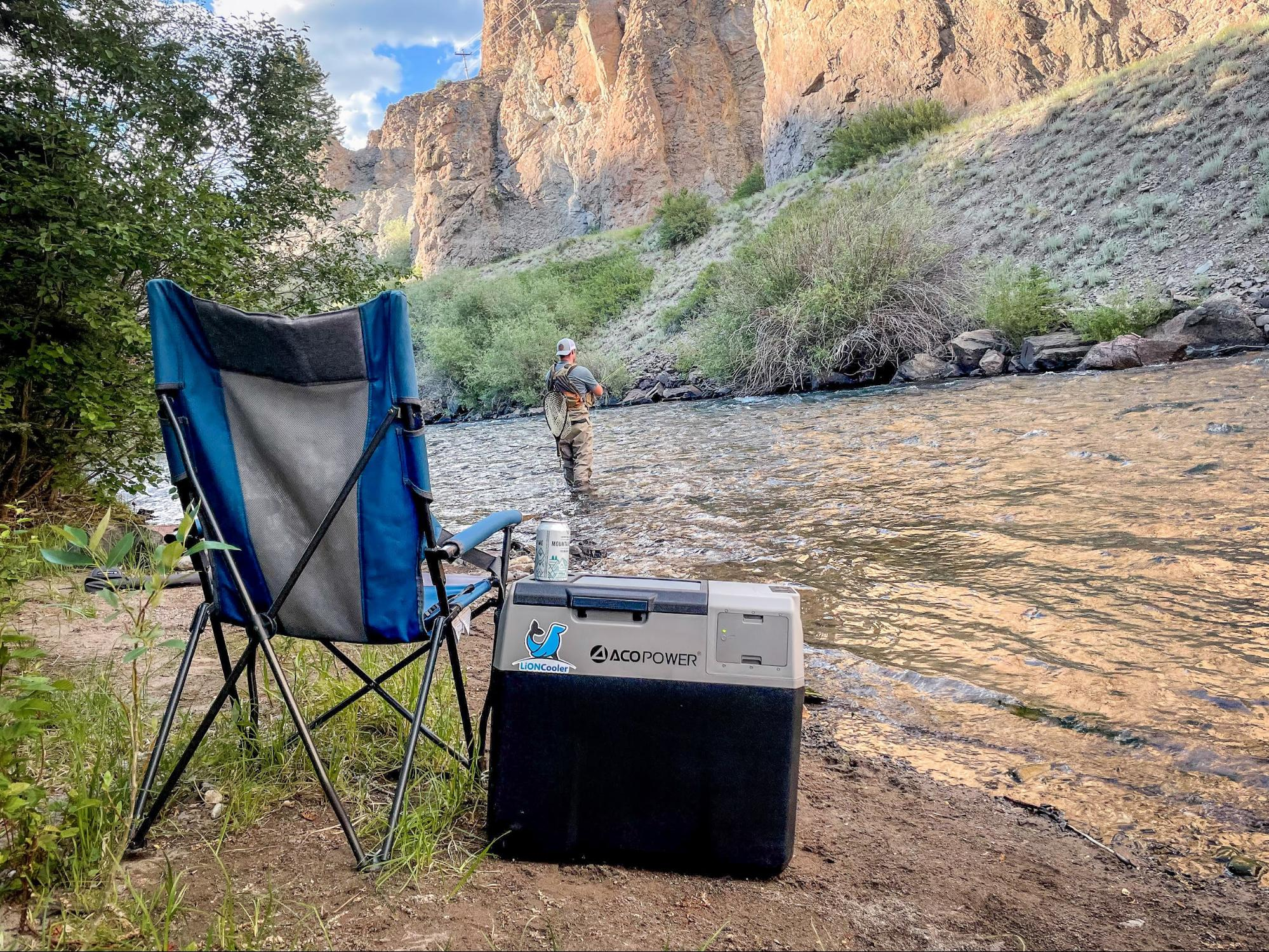 LionCooler X40A Portable Fridge Freezer Cooler by ACOPower next to a camp chair