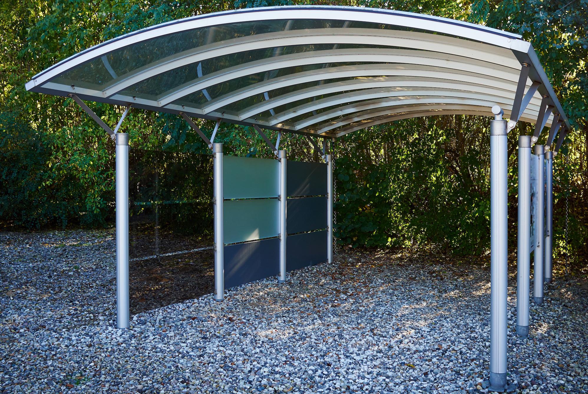 Modern metal carport car garage parking made of silver metal and glass
