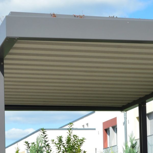 New Metal Carport with greened Roof in Front of a Multi Family residential Building